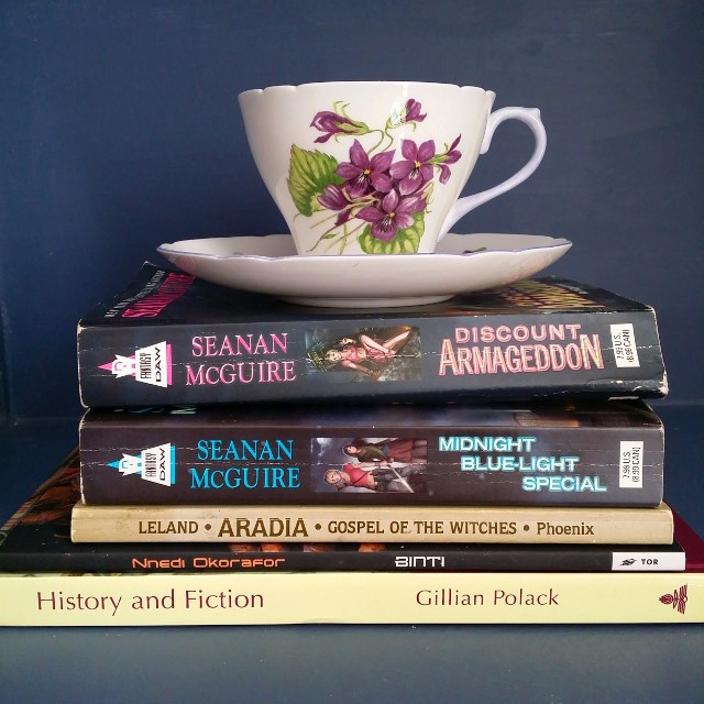 Mt TBR, History and Fiction, Gillian Polack, Binti, Nnedi Okorafor, Aradia, Charles Leland, Seanan McGuire, Discount Armageddon, Midnight Blue-light Special, InCryptid, tea cup, tea and books