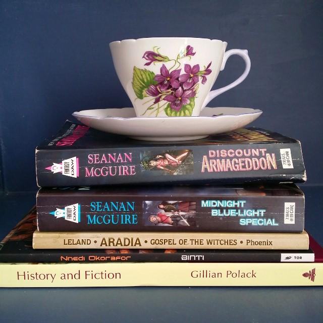 Mt TBR, History and Fiction, Gillian Polack, Binti, Nnedi Okorafor, Aradia, Charles Leland, Seanan McGuire, Discount Armageddon, Midnight Blue-light Special, InCryptid, tea cup, tea and books